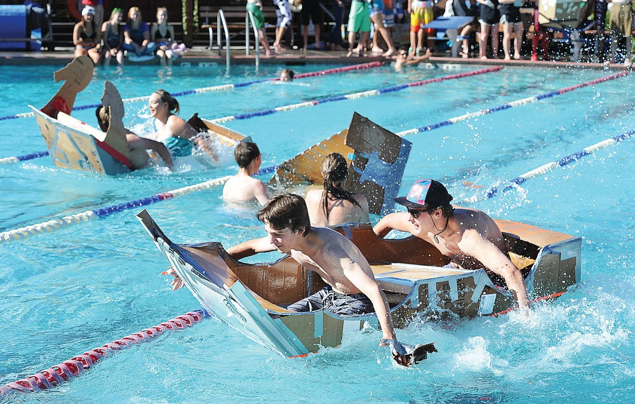 Xander Couchoud and Kane Park race across the Old Town Hot Springs pool Friday morning during the Cardboard Classic. The races featured physics students and their vessels from Steamboat Springs High School and South Routt.