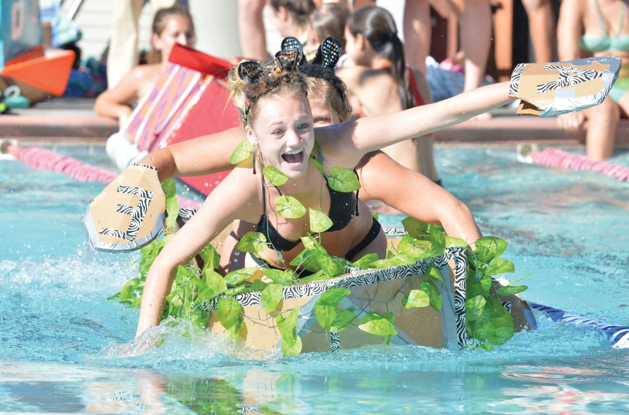 Steamboat Springs juniors Alison Speer, front, and Ellese Lupori race across the Old Town Hot Springs pool Friday morning during the cardboard classic. The races featured physics students, and their vessel from Steamboat Springs High School and South Routt.