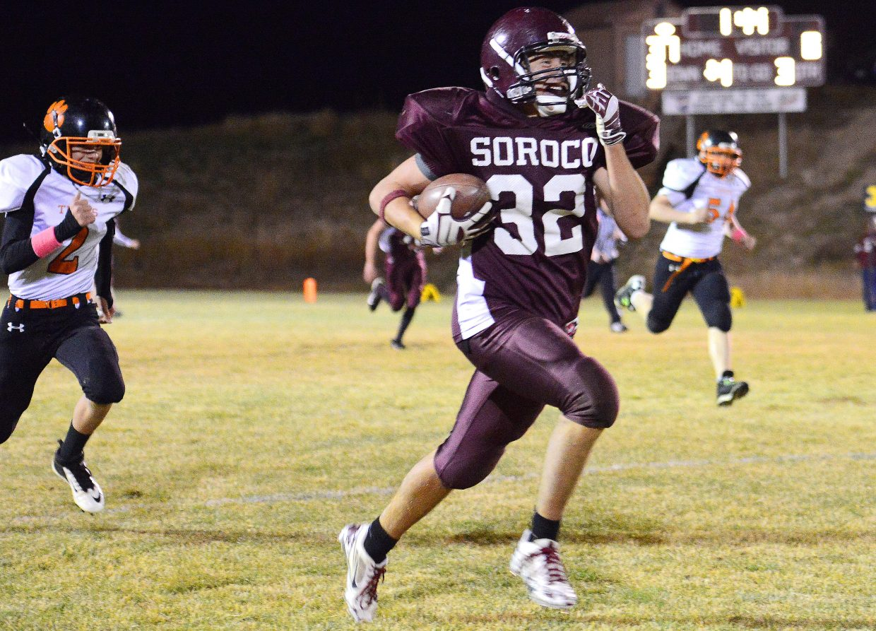 Soroco's Micah Gibbons grins wide and sprints down the field Friday after hauling in a pass from Rams' quarterback Warren Hayes. Gibbons didn't quite score on the play, but his team did get in for a touchdown on the drive in what was a lopsided win against rival Hayden.