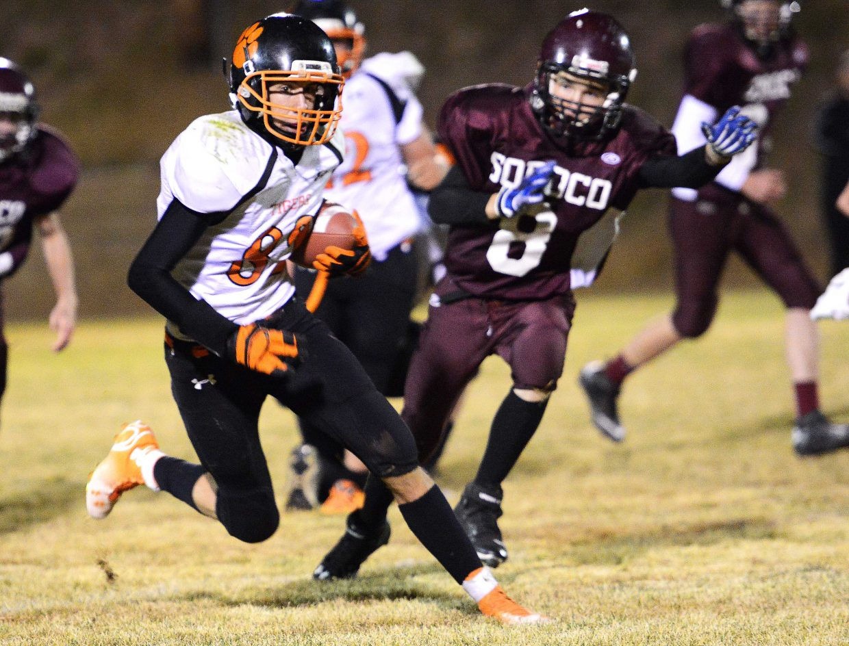 Hayden's Tanner Guire makes a cut en route to a touchdown Friday.