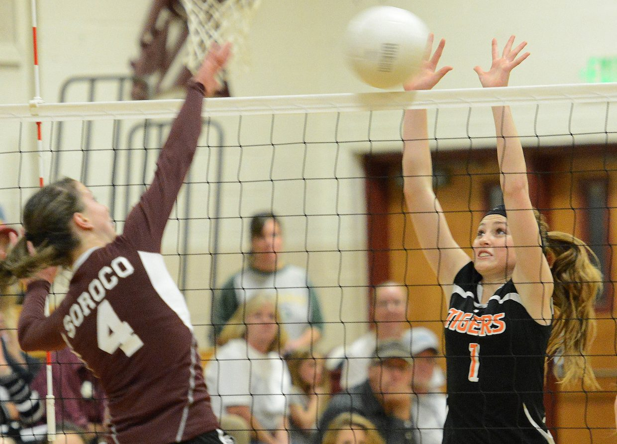 Hayden sophomore Darian Murphy gets up for a block against Soroco's Laramie Parker on Friday. Both Hayden and Soroco failed in their bids to advance in this weekend's district volleyball tournament, but the Tigers beat the Rams in pool play, their first win in the rivalry in three tries this season.