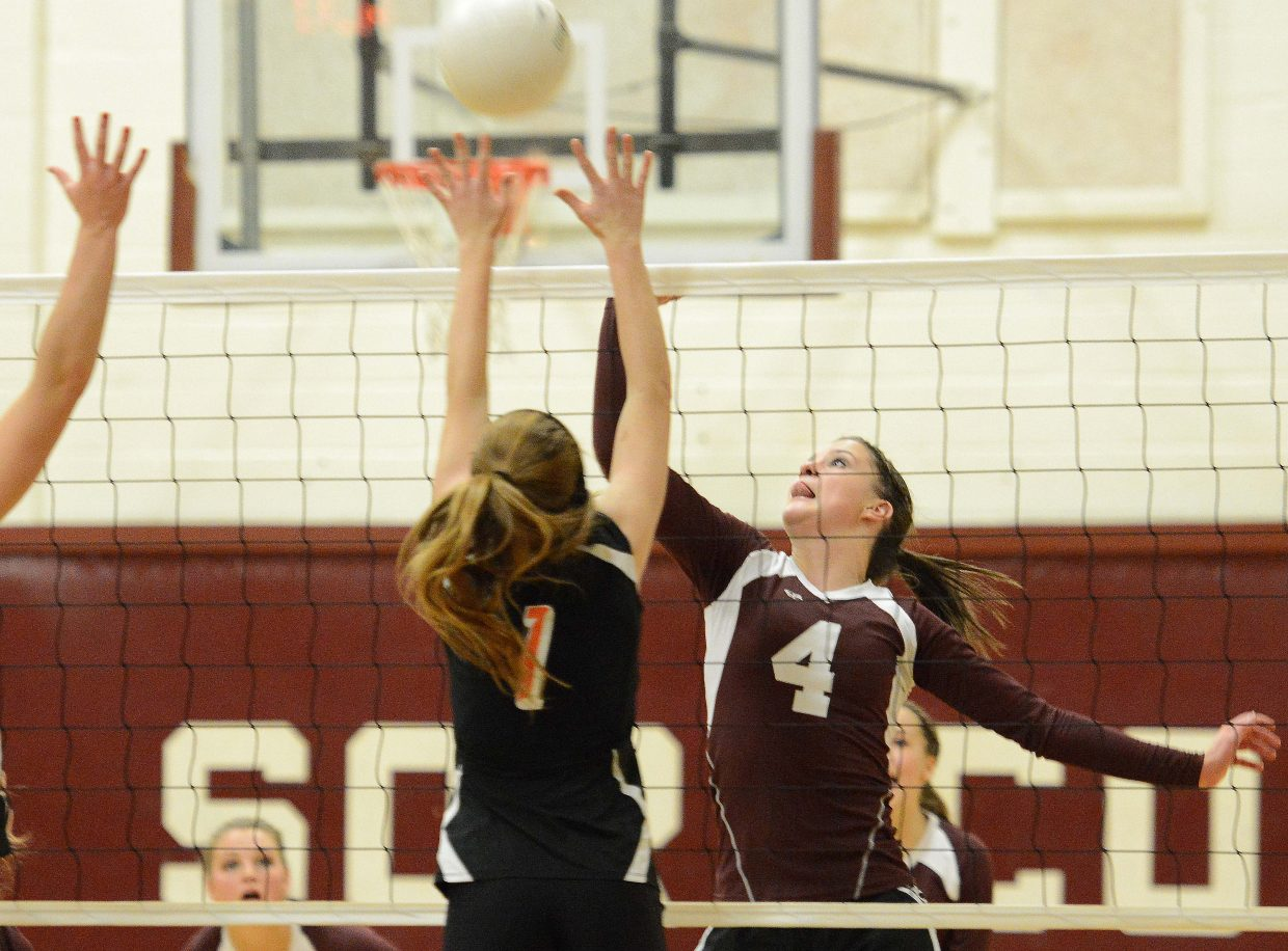 Soroco's Laramie Parker taps the ball over the net Friday against Hayden.