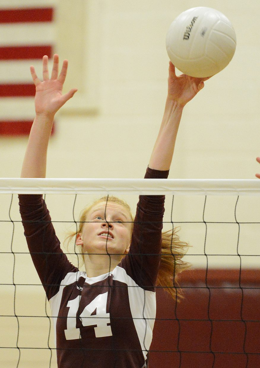 Soroco's Lucy Carlson reaches just high enough for a block Friday against Hayden.
