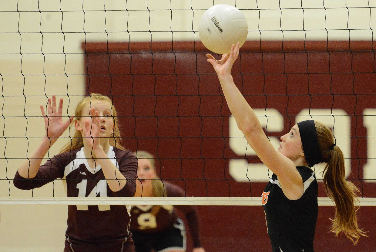 Hayden's Darian Murphy sets the ball Friday.