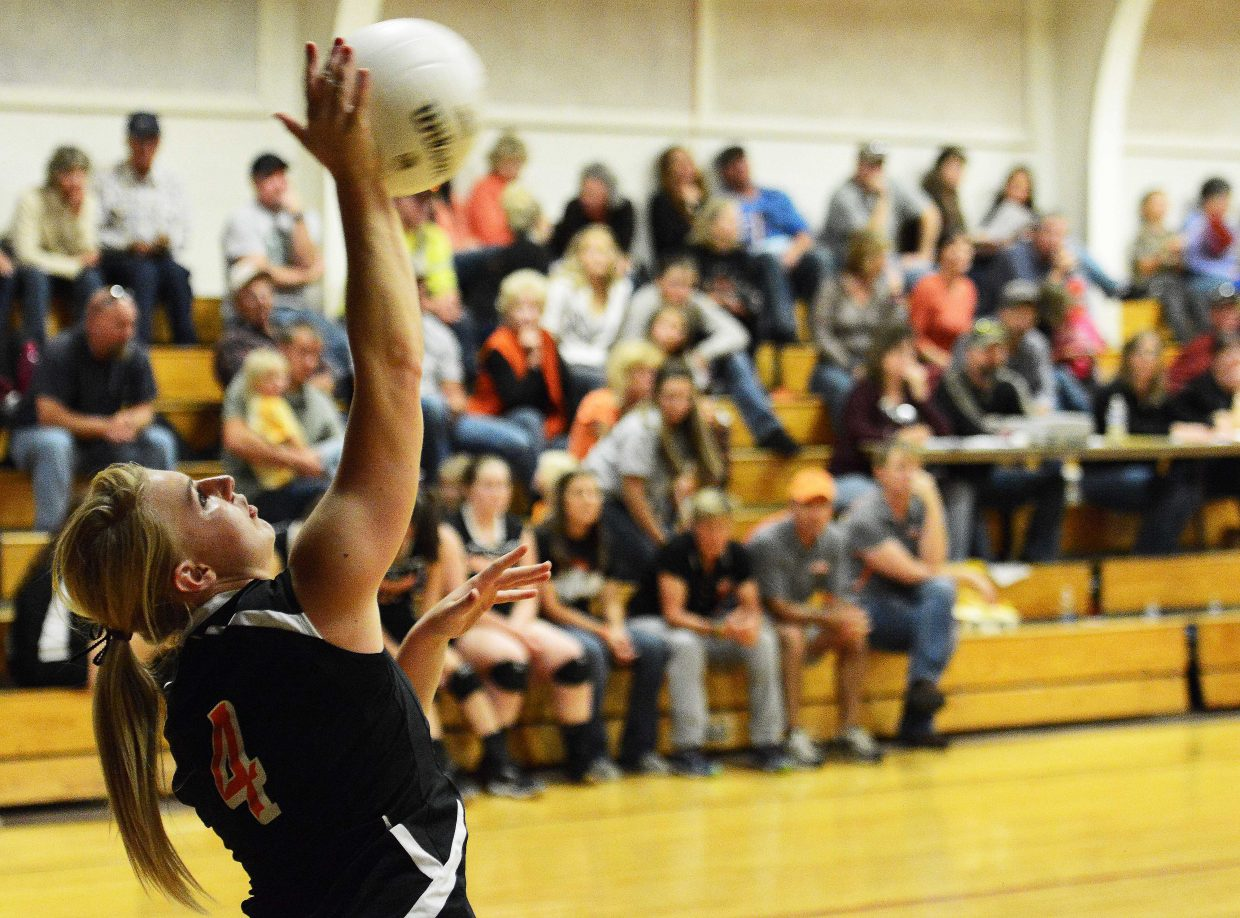 Hayden senior Jordan Temple serves up the ball Friday.