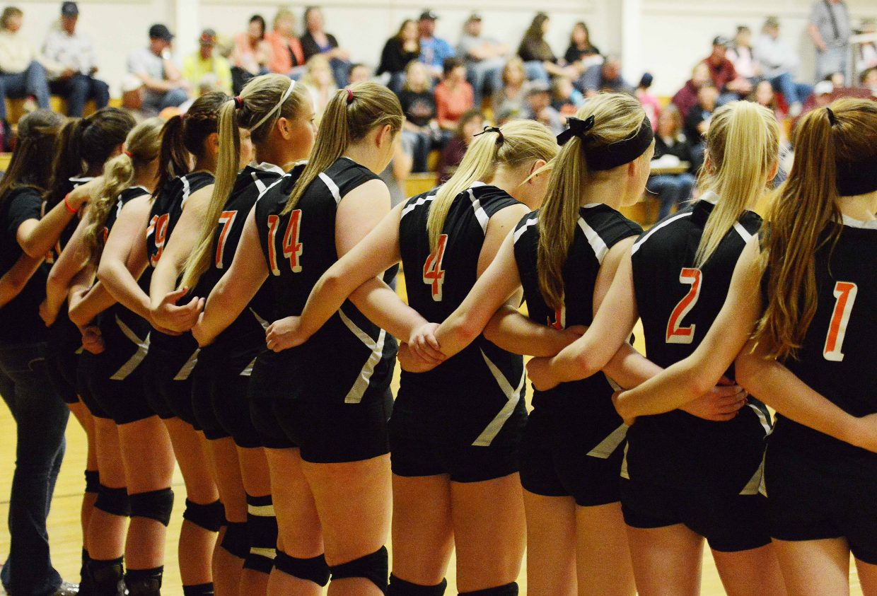 The Hayden High School volleyball team waits before the start on a match on Friday.