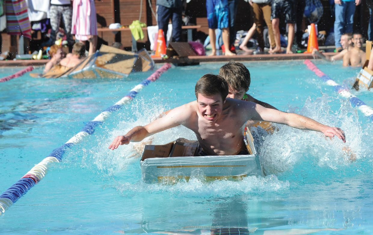 Calvin Kunst, front, and Josh Corbin race across the pool at Old Town Hot Springs on Friday morning. The students designed the watercraft in Eric Nilsson's physics class and raced it as part of an exam.