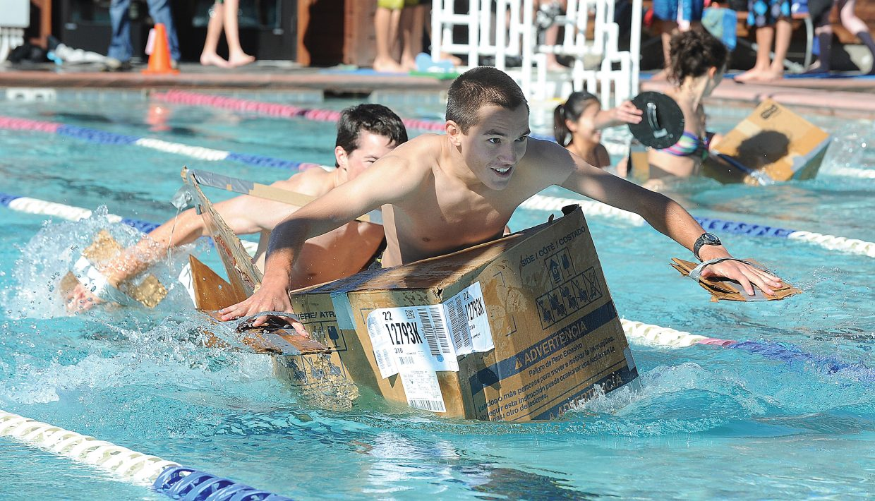 Aidan Gibbs, front, and Tanner Visnick race across the pool at Old Town Hot Springs on Friday morning.