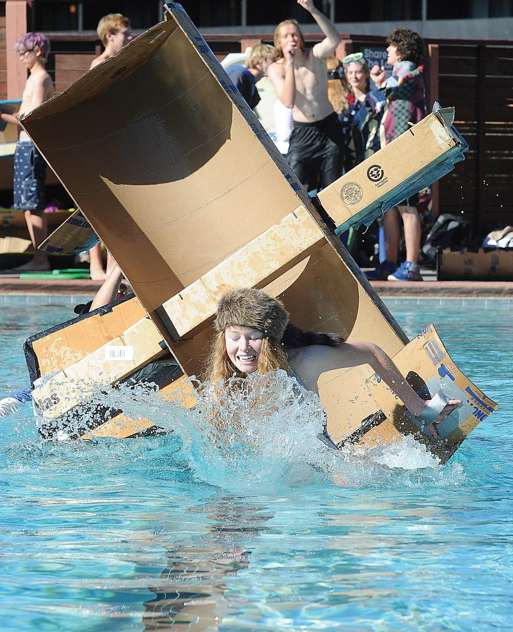 Shannon Ross takes a plunge at Old Town Hot Springs on Friday morning as part of the cardboard classic boat race.