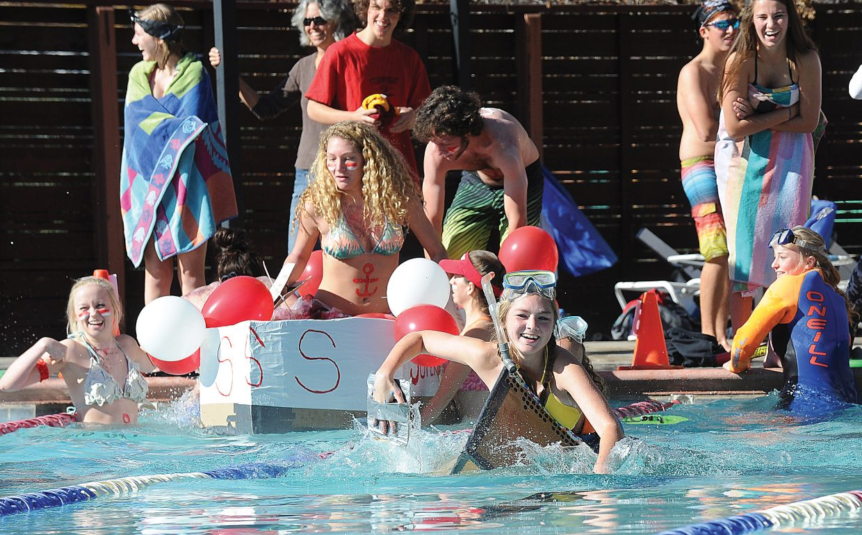 Megan Williams attempts to make it across the swimming pool at Old Town Hot Springs on Friday as part of an exam for her high school physics class.