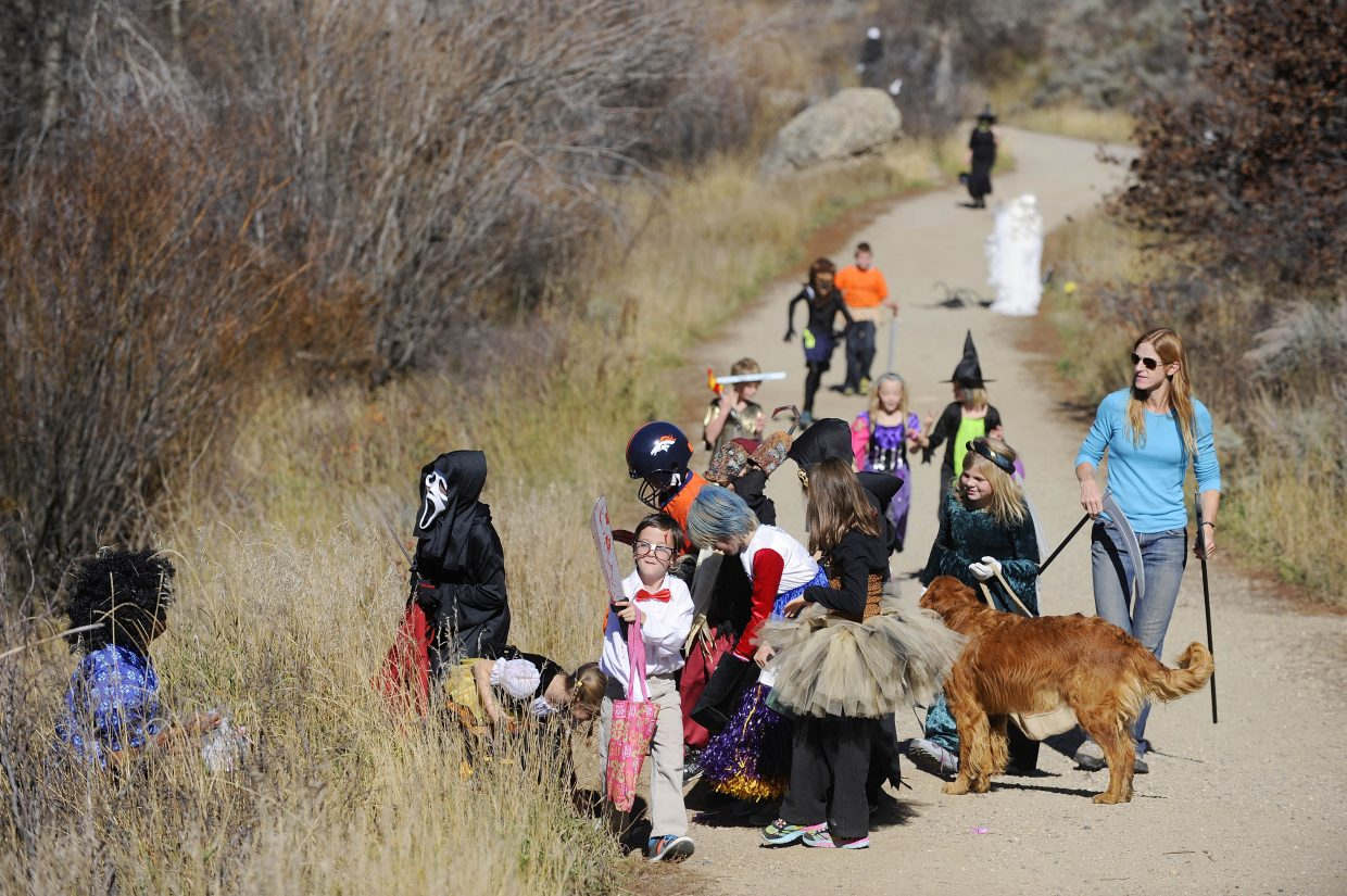 Elementary school students get some scares and candy Saturday during a hike along the Butcherknife Trail. The students were celebrating Halloween and second grader Sunny Diehl's birthday.