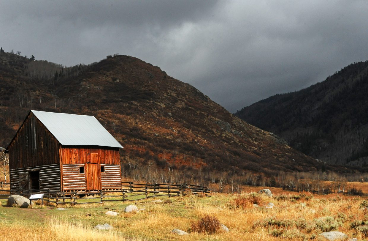 The Mad Creek Barn shines during a quick break between the rain clouds Tuesday afternoon.