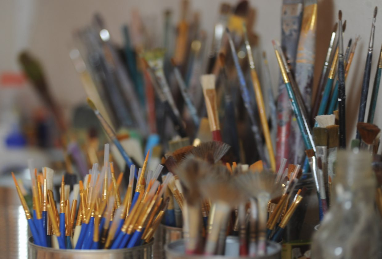Paintbrushes fill several repurposed cans in Gregory Block's studio in Steamboat Springs.