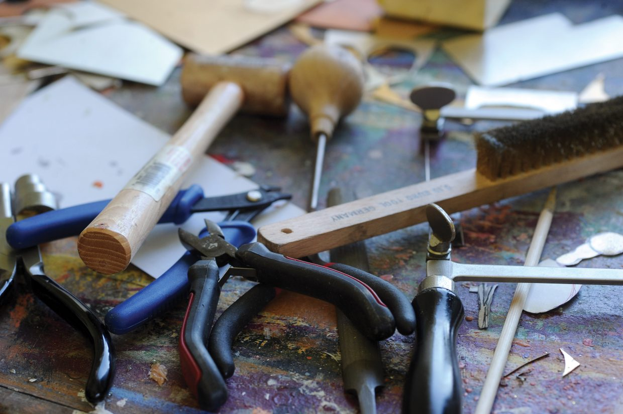 The tools of a jewelry maker lie on a table in Sandra Sherrod's Steamboat Springs studio.