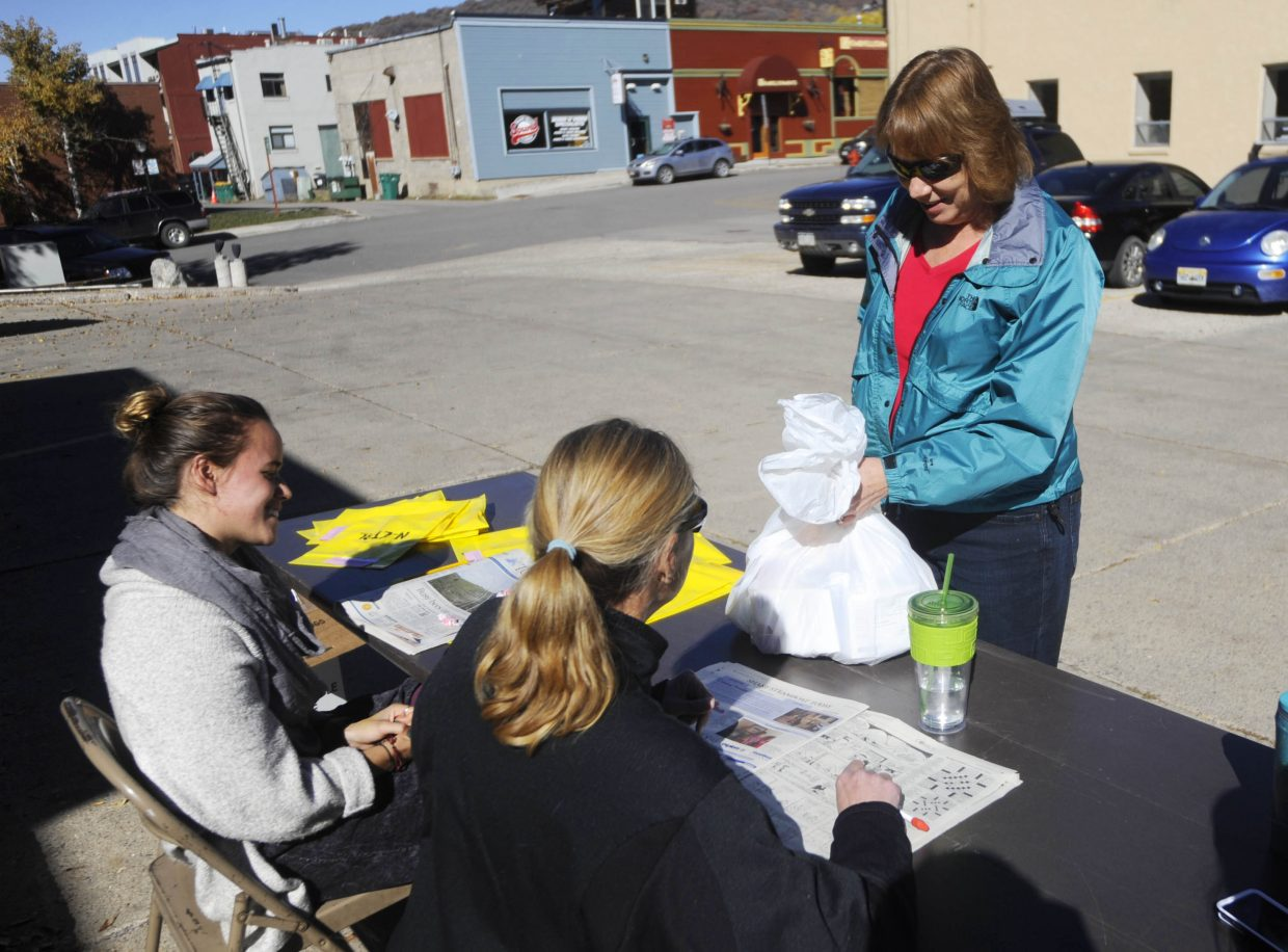 Sharon Pace drops off items during the Prescription Take Back Day in October at the Steamboat Springs Police Department. The event will take place again from 10 a.m to 2 p.m. Saturday at the police department and the Oak Creek Town Hall.