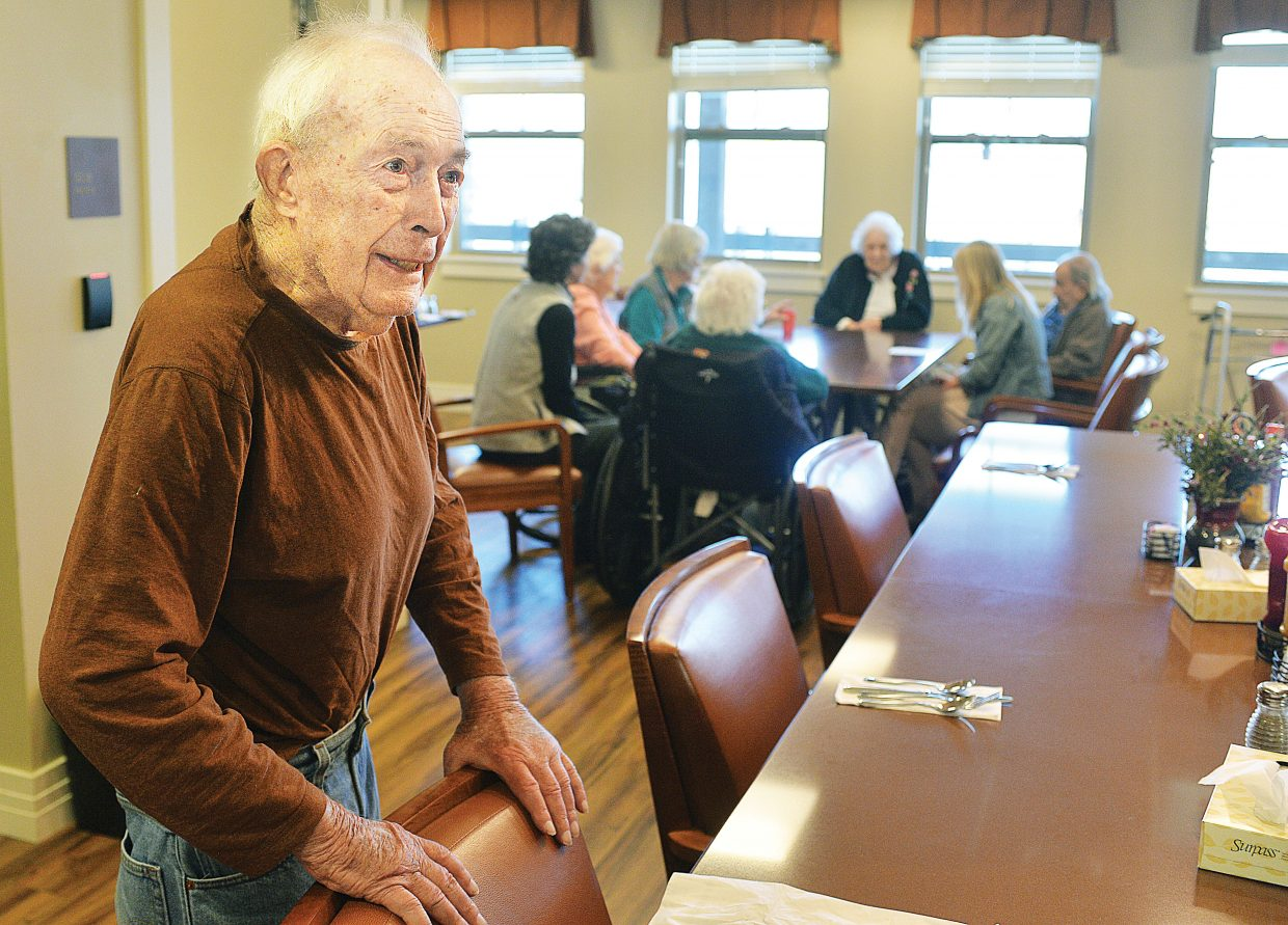 Stan Whittemore, a Casey's Pond Senior Living resident, takes a break from a game of Yahtzee to talk to visitors in the assisted living center.