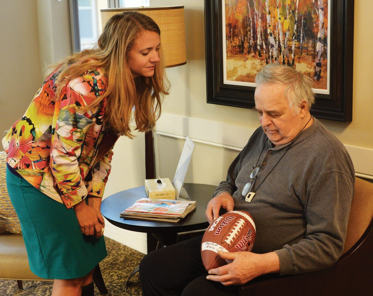 Casey's Pond Senior Living memory care patient Harland Svare talks with Kelly Ornberg, marketing and membership director, at the center in Steamboat Springs.