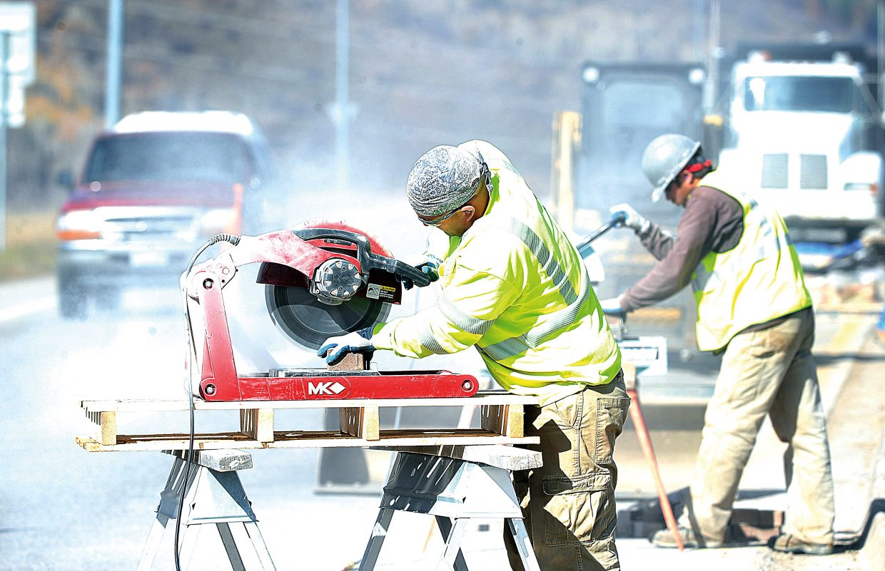 Brian Buckland cuts bricks for the median improvements on the east side of Steamboat Springs on Monday afternoon.