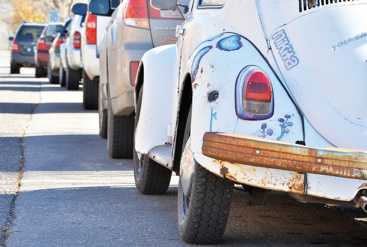 A line of cars is parked Tuesday on Yampa Street.