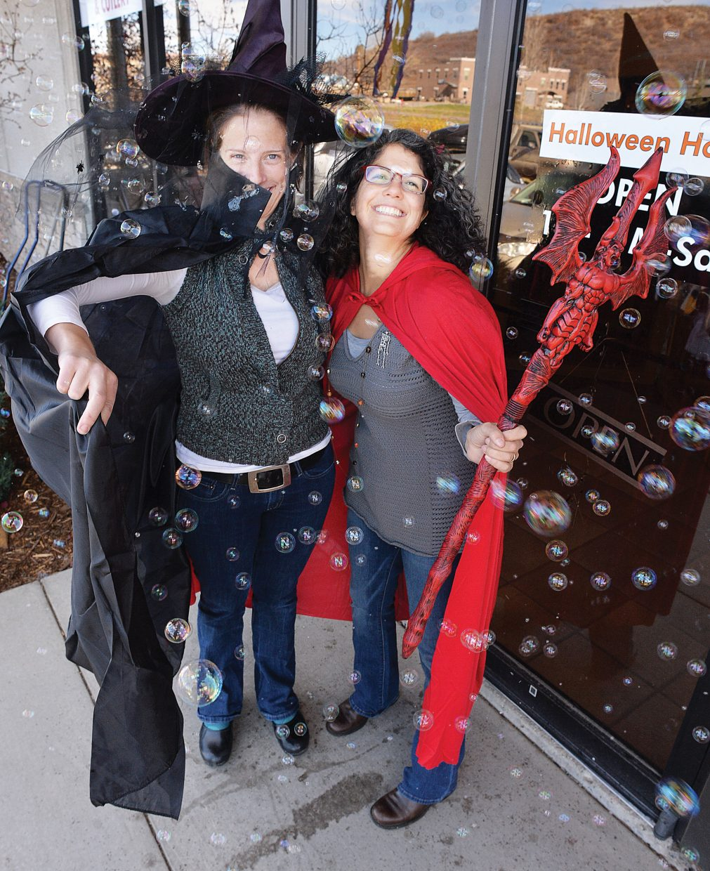 Colorado Event Rentals owner Torey Wodnik, left, and employee Lisa Warner goof around outside the store Tuesday afternoon in Steamboat Springs. The business has stocked up on Halloween costumes and is expecting things to get pretty busy the next few days as All Hallows' Eve draws closer. There will be plenty to do this Friday as locals celebrate the holiday in Steamboat Springs.