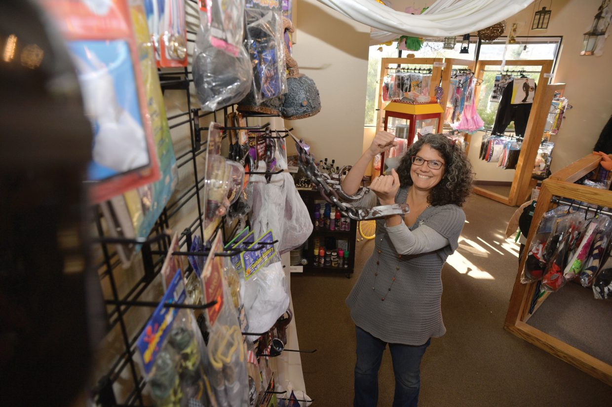 Colorado Event Rentals employee Lisa Warner goofs around inside the store Tuesday afternoon in Steamboat Springs. The business has stocked up on Halloween costumes and is expecting things to get pretty busy the next few days as Halloween draws closer. There will be plenty to do Friday as locals celebrate the holiday in Steamboat Springs.