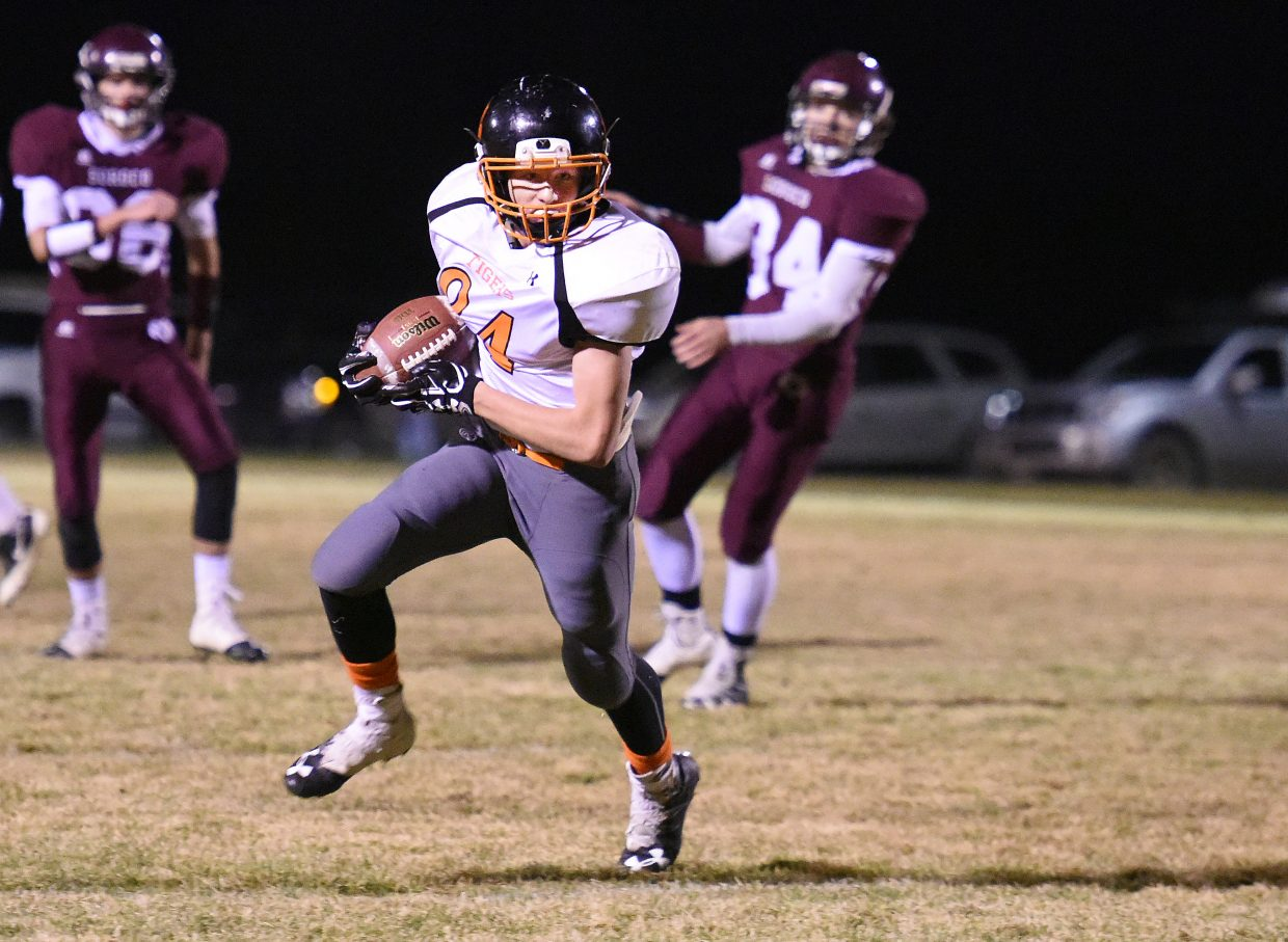 Hayden's Mason Brewer turns up field after a catch Friday against Soroco.