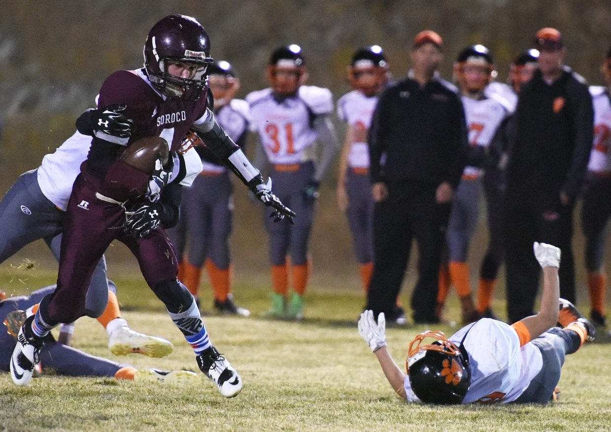 Soroco senior Sarvis Anarella tries to break through a pack of Hayden defenders after catching a pass Friday night. Anarella had one touchdown receiving as the Rams grabbed a big win against the Tigers.