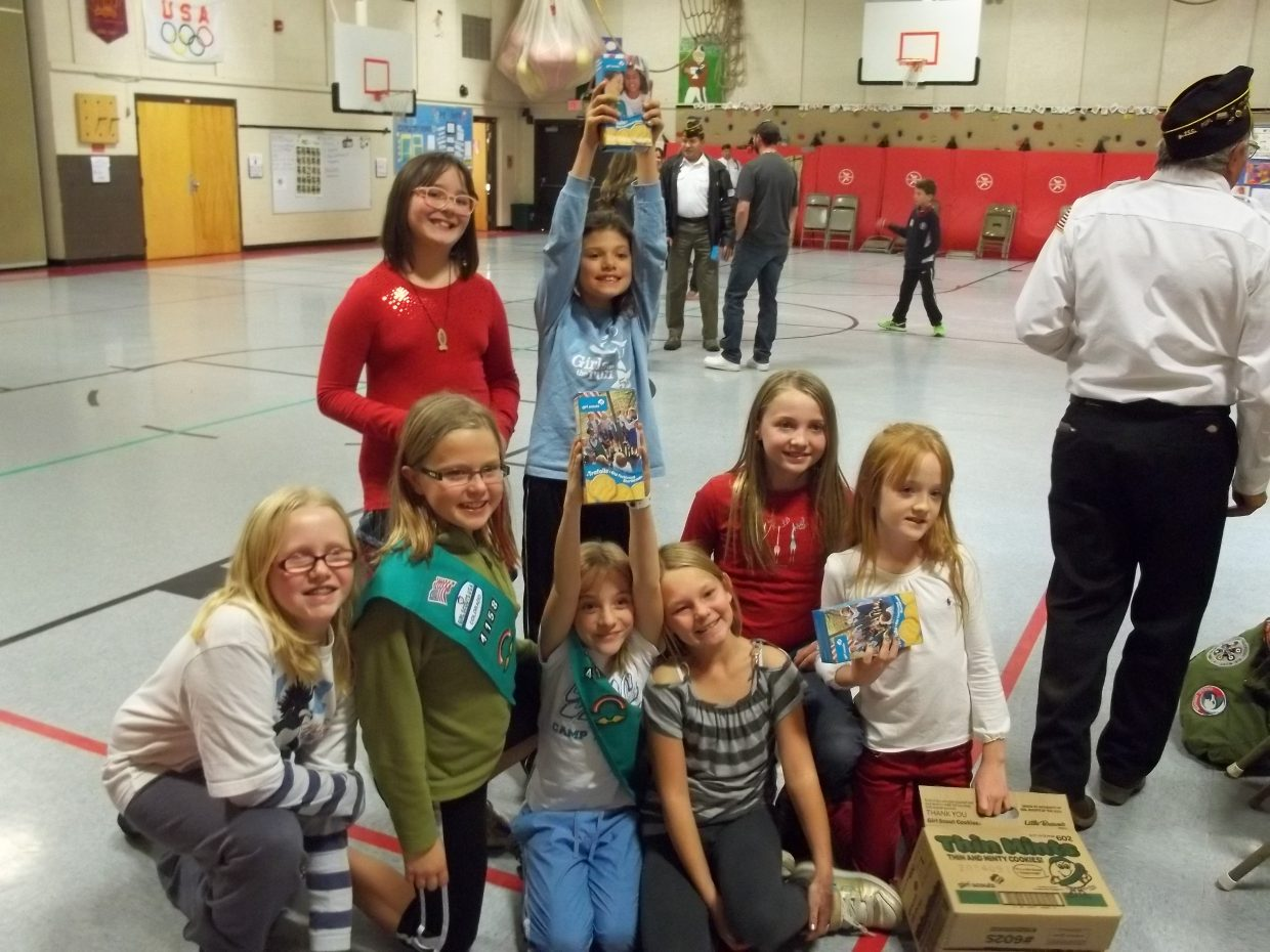 Girl Scout Troop 4158 collected 58 boxes of donated cookies for local veterans and presented them to some veterans after the Veterans Day ceremony at Strawberry Park Elementary school. Submitted by: Courtnay Thunstrom
