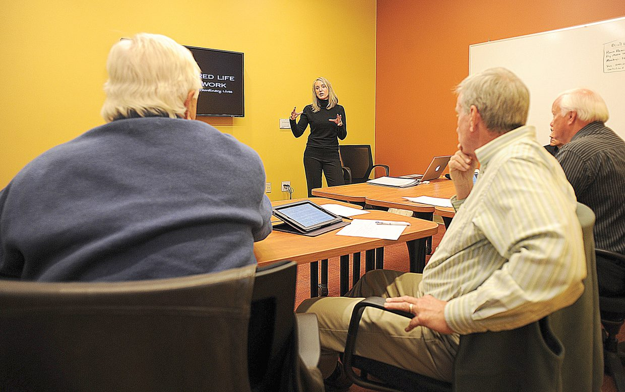Caroline Lalive presents her vision for Inspired Life Network, which would facilitate women's empowerment seminars, to the judges of the 2013 Business Plan Competition hosted by Colorado Mountain College and Yampa Valley SCORE.