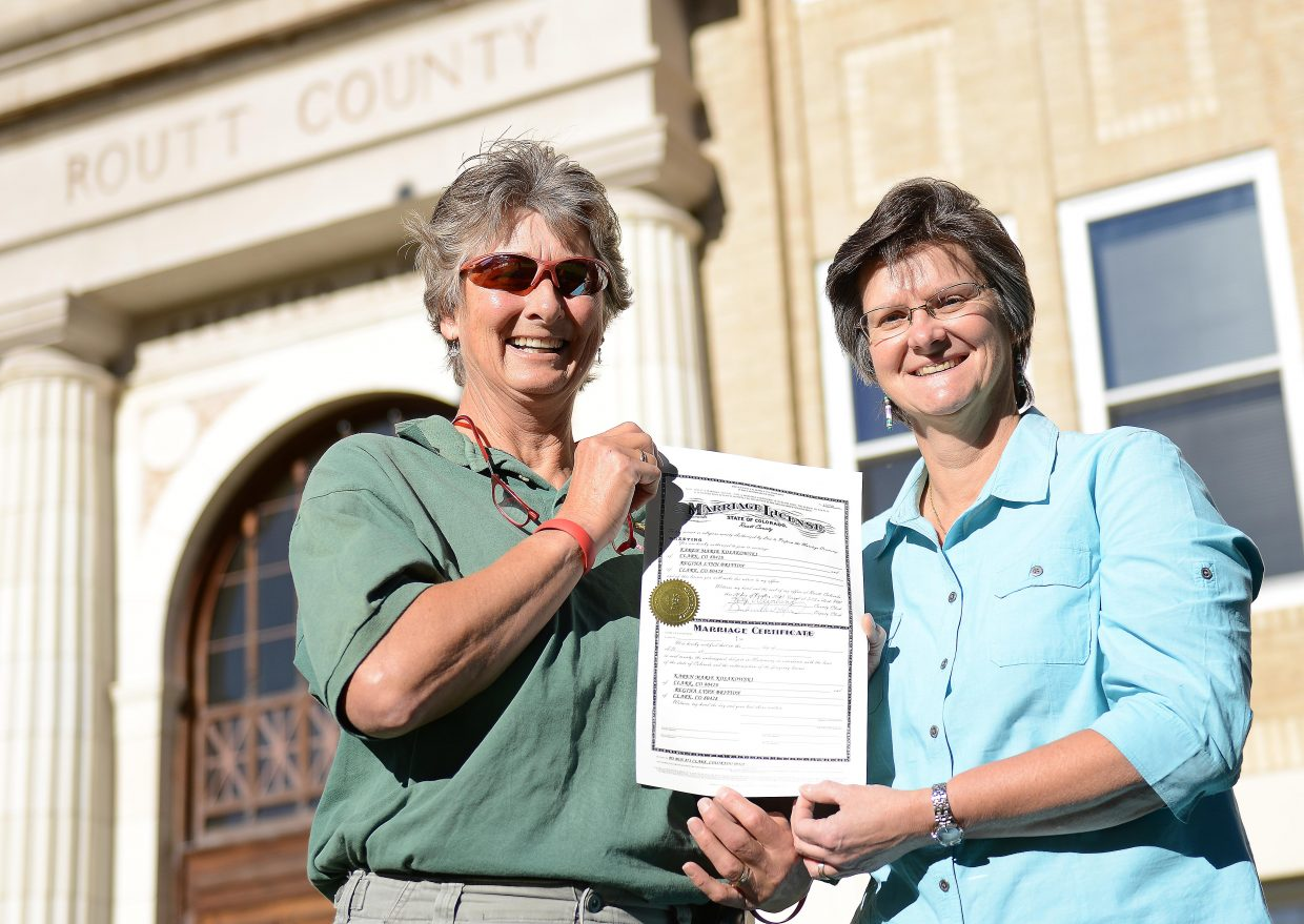 Regina Britton, left, and Karen Kosakowski stand outside the Routt County Courthouse after becoming the first same-sex couple to be granted a marriage license in the county. The North Routt couple said they were relieved when a recent United States Supreme Court decision opened the door for their marriage in their home state. They didn't hurry the process, however. They said their visit to the courthouse in Steamboat Wednesday wasn't about politics and that they'd waited to talk with their families and begin planning their wedding before getting their marriage license.