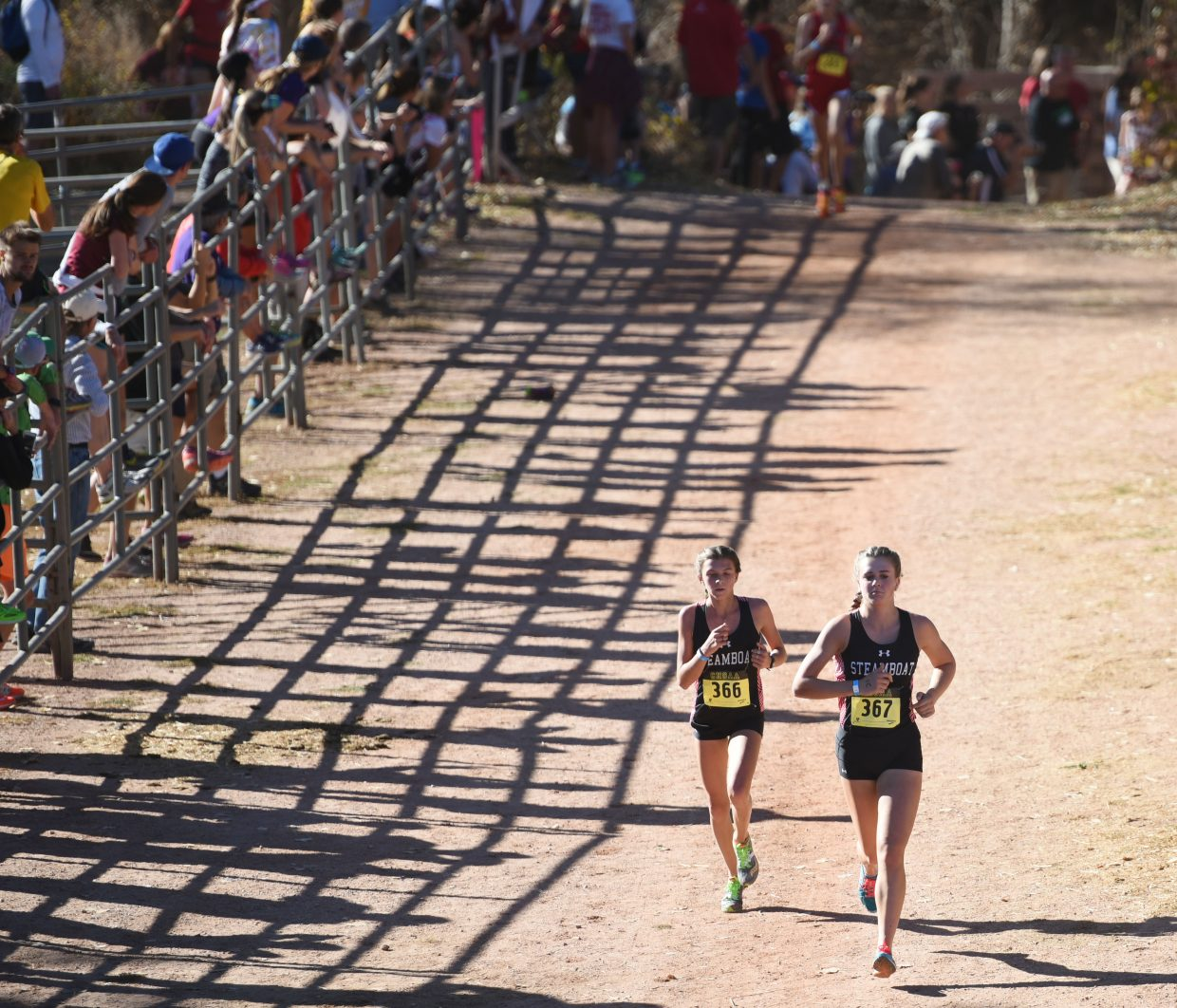 Steamboat freshman Maggi Congdon, left, and junior Sadie Cotton run toward the finish line Saturday at the Class 3A state cross country championships in Colorado Springs. The pair finished 17th and 18th respectively.