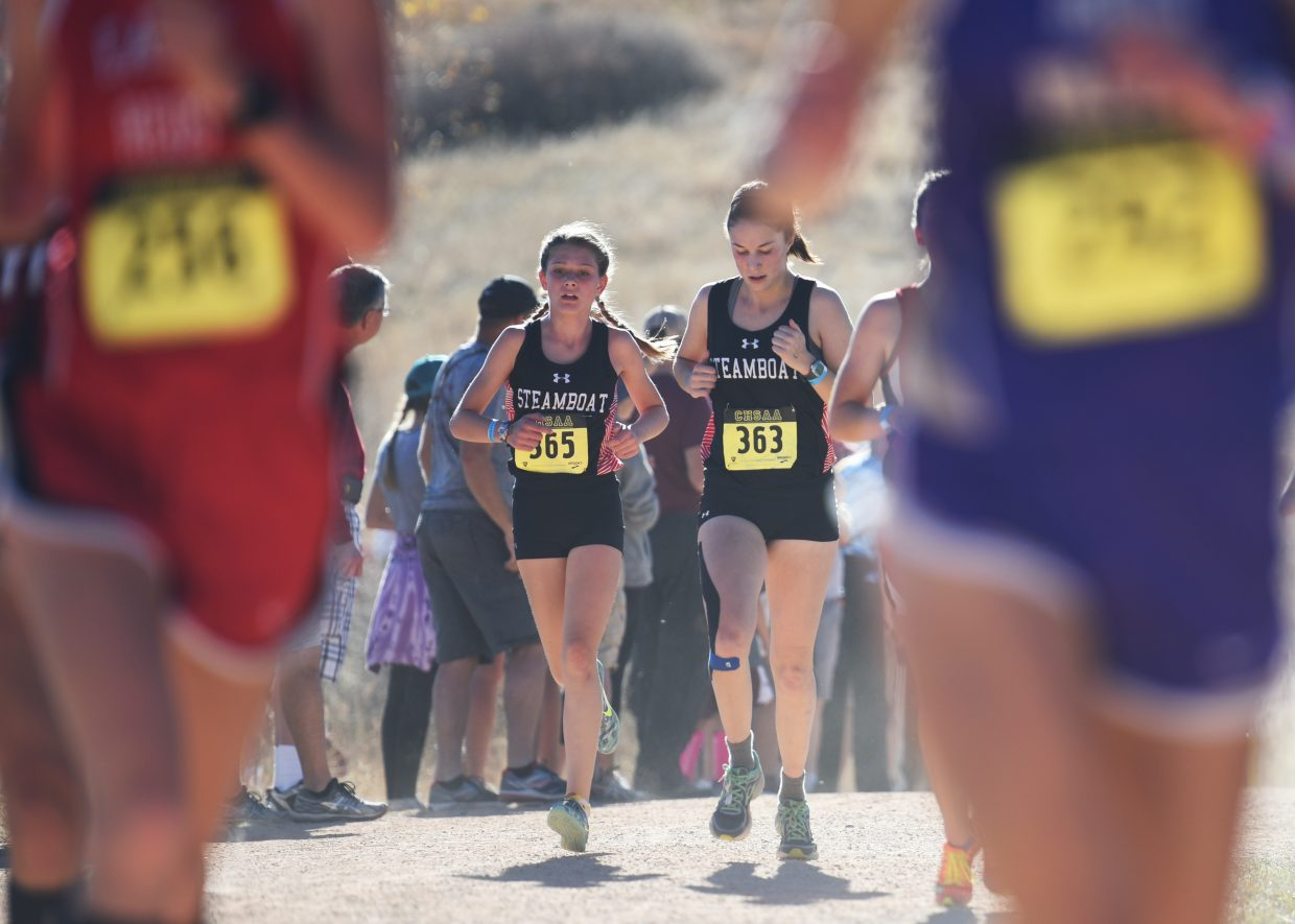 Isabelle Boniface, left, and Meg Anderson run Saturday at the Class 3A state cross country meet in Colorado Springs. Boniface went on to finish 75th in the race and Anderson 68th.