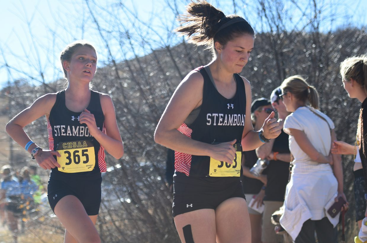 Isabelle Boniface, left, and Meg Anderson run Saturday at the Class 3A state cross country meet in Colorado Springs.
