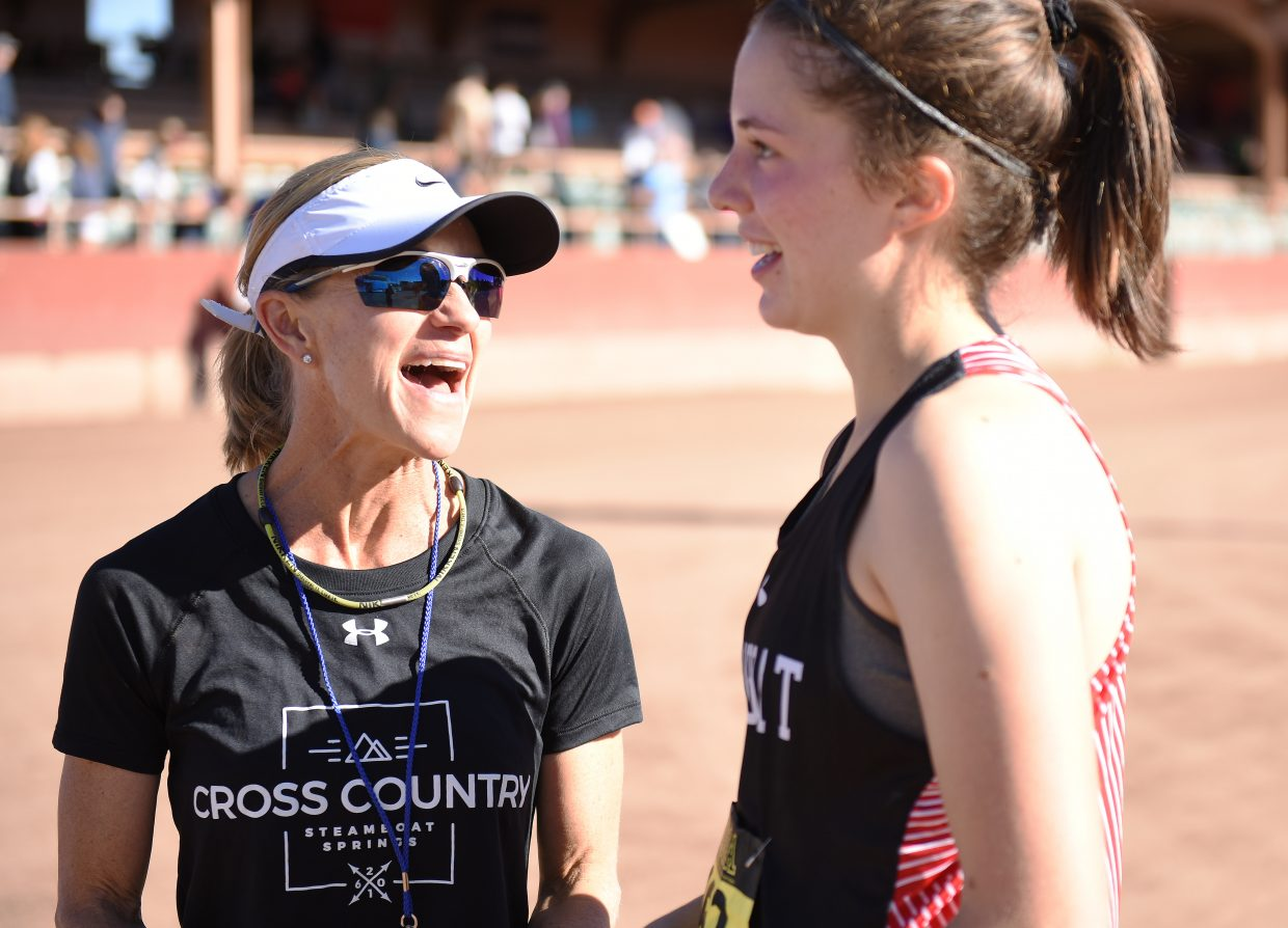 Steamboat Springs High School cross country coach Lisa Renee Tumminello talks with senior Meg Anderson on Saturday at the state cross country meet in Colorado Springs.