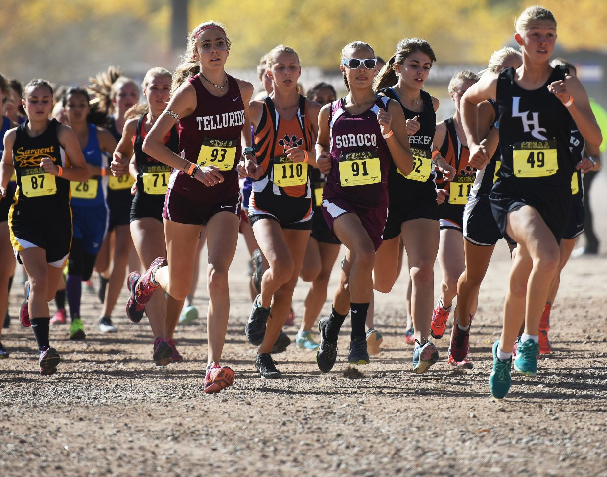 Chloe Veilleux runs at the front of the pack near the start of Saturday's Class 2A state championship cross country race.