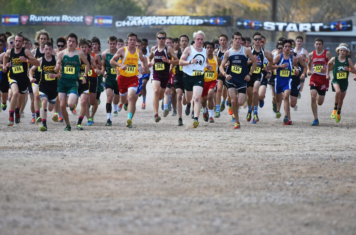 Soroco's Ben Kelley, center, fights near the front of the pack at the start of the Class 2A boys state cross country race in Colorado Springs.
