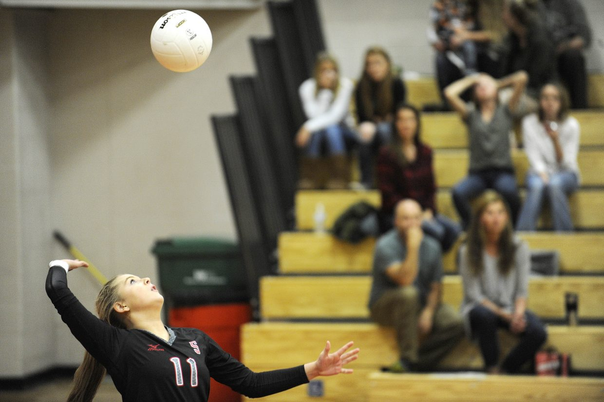 Steamboat Springs High School junior Hannah McCreight serves the ball during Saturday's match against Rifle.