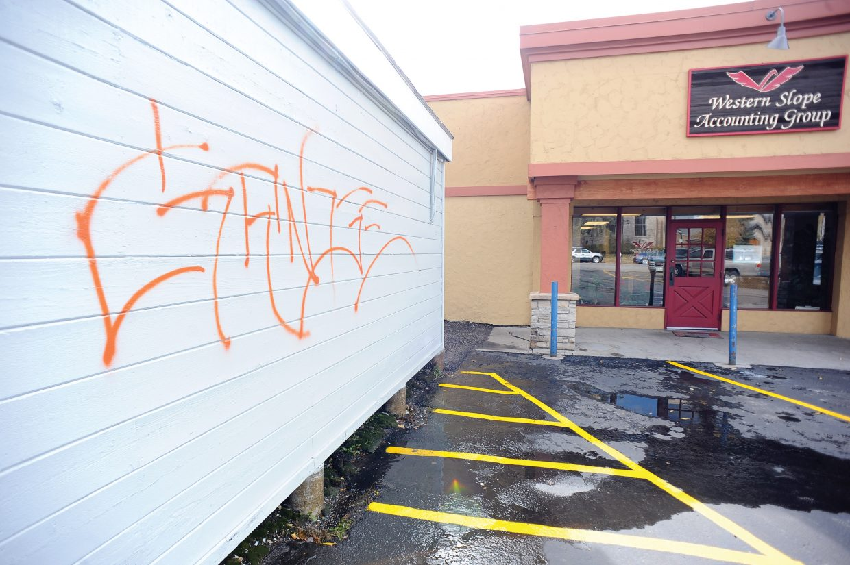 The siding on Spostas World Sushi was the target of a vandal Tuesday night. Police arrested the man Wednesday morning.