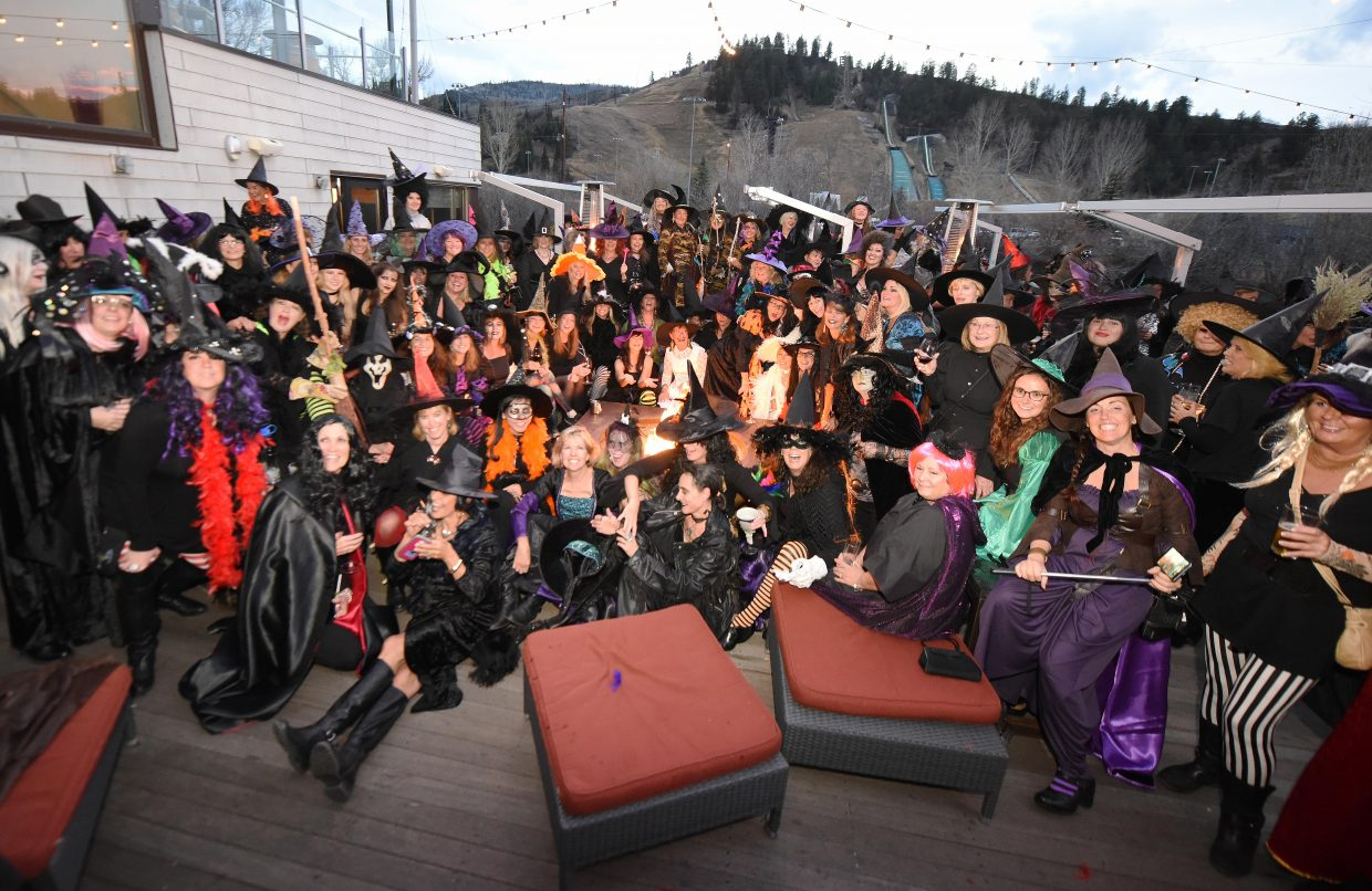"""Double double toil and trouble: More than 100 Steamboat Springs witches gathered Sunday evening around their """"cauldron"""" at Aurum Food and Wine in downtown Steamboat Springs. The coven cackled into the dark the night before Halloween during their annual Witch's Night Out party in Steamboat. The event started with eight friends about 25 years ago."""