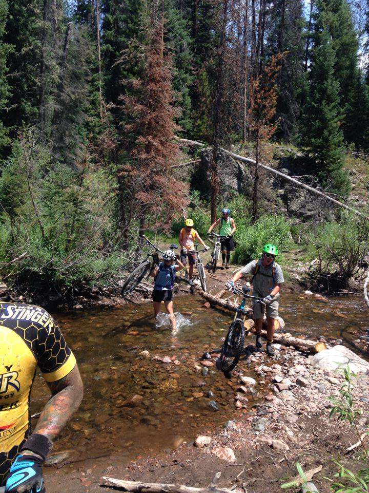 On Scott's Run, near the Hinman Park Trail, Eric Schankerman and friends cross a stream to continue on the biking adventure up in North Routt.
