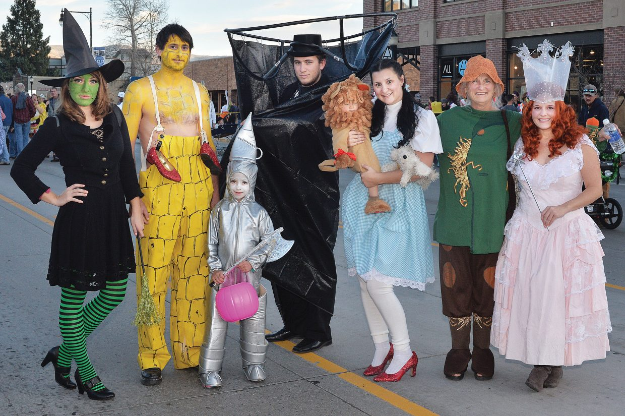The Chase family followed the yellow brick road to downtown Steamboat Springs for Friday evening's Downtown Halloween Stroll. The family, from left, included Iliana Chase, Dmitrt Chase, Mya Chotvacs-Chase, Vladan Chase, Ikga Chase, Meagan Chase, Camilla Haight and the cowardly Lion, Paxton Haight.
