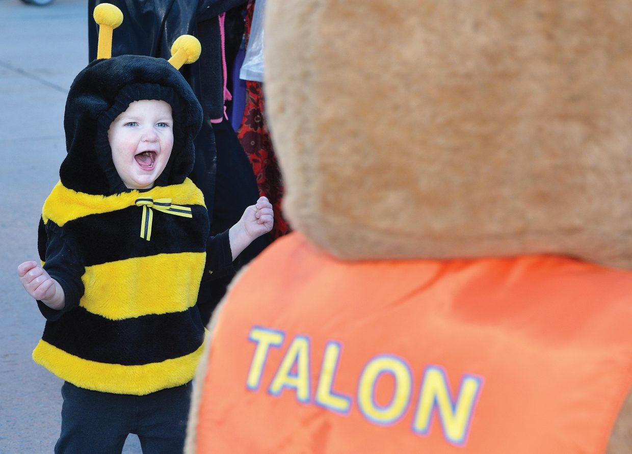 Young Tristan Schultz couldn't get enough of Talon the Eagle at Friday night's downtown Halloween Stroll on Lincoln Avenue. The annual holiday event drew hundreds of children and their parents to downtown Steamboat Springs for the chance to pick up a few treats from local merchants.