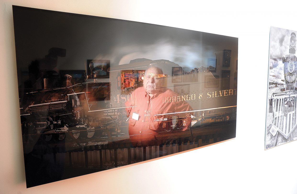 Al Reiner is reflected in one of the photographs he currently has on display at the Steamboat Springs Center for Visual Arts in downtown Steamboat Springs. Reiner's most recent work focuses on trains.