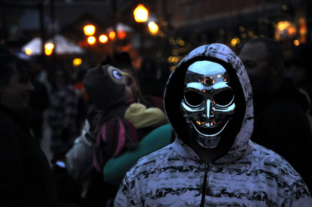 Stagecoach resident George Decorte sports a spooky metallic mask Thursday night at the Steamboat Springs Halloween Stroll.