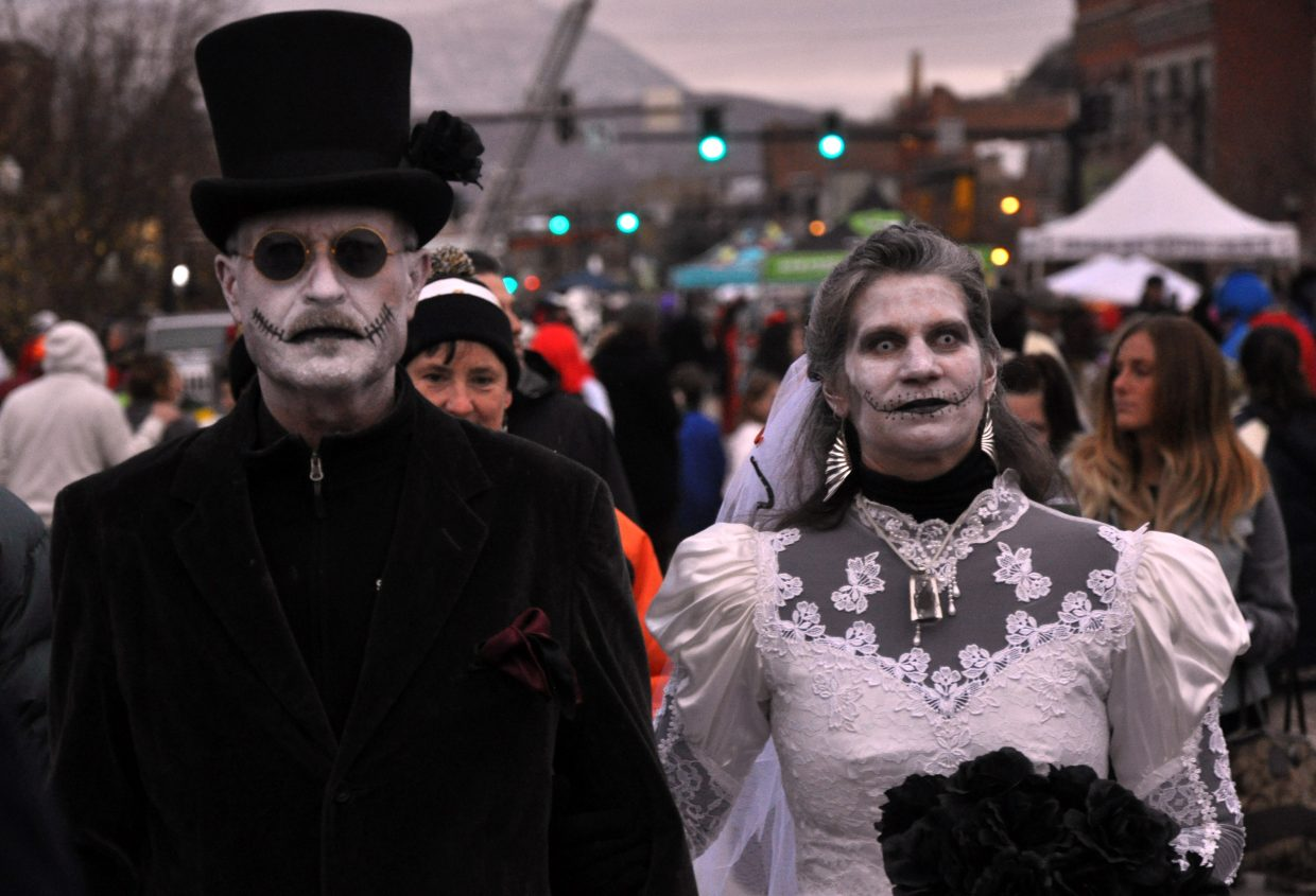 Stanzi and Robin Lucy stand out from the crowd as a zombie bride and groom.