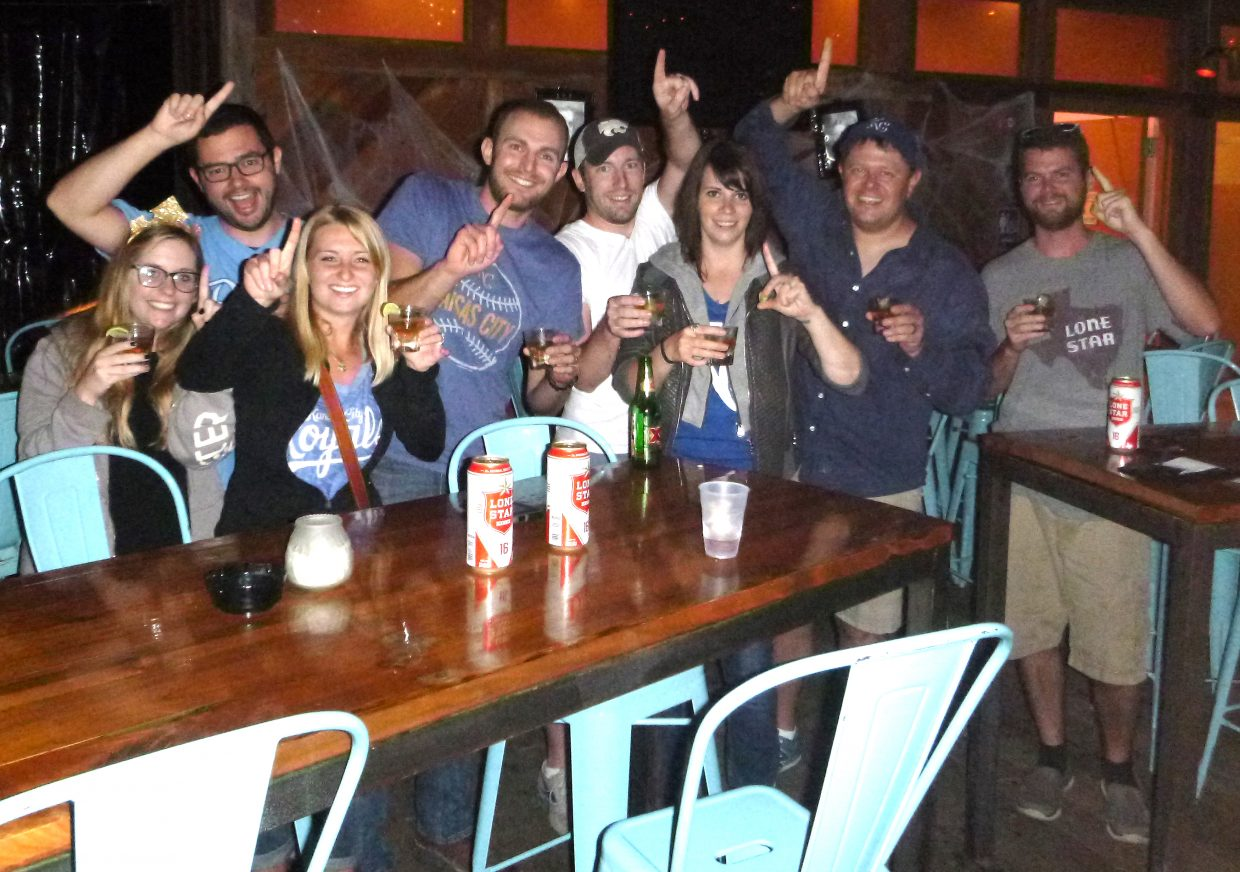 There weren't a lot of Kansas City Royals fans in Austin, but a few banded together to watch the World Series in an otherwise abandoned bar, celebrating in the silence when the Royals won the championship after a five-run 12th inning in Game 5.