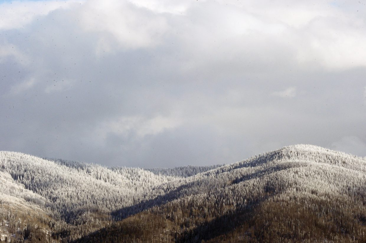 A light dusting of snow covers the slopes Friday near Steamboat Springs. Temperatures are expected to dip Monday night, with several inches of snow forecast to accumulate at midmountain.