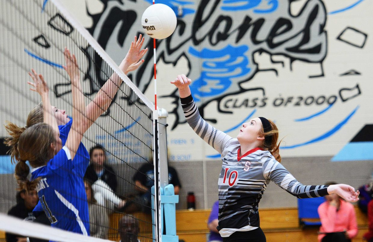 A pair of Pueblo West defenders come up for a block against Steamboat's Hayley Johnson on Saturday during the regional volleyball tournament in Pueblo. The Sailors lost both their matches at the tournament, ending their season.