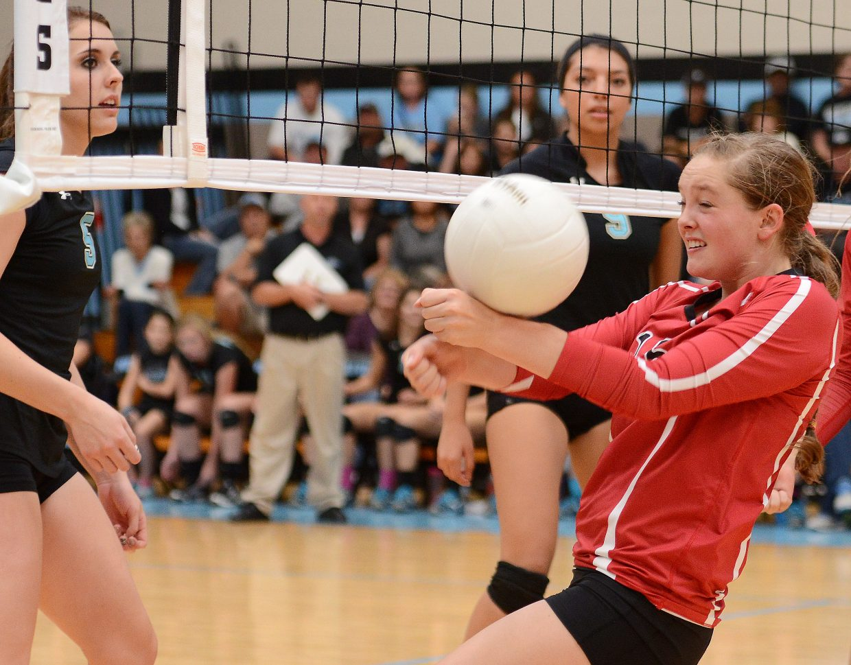 Steamboat's Jenna Miller tries to save a point Saturday.