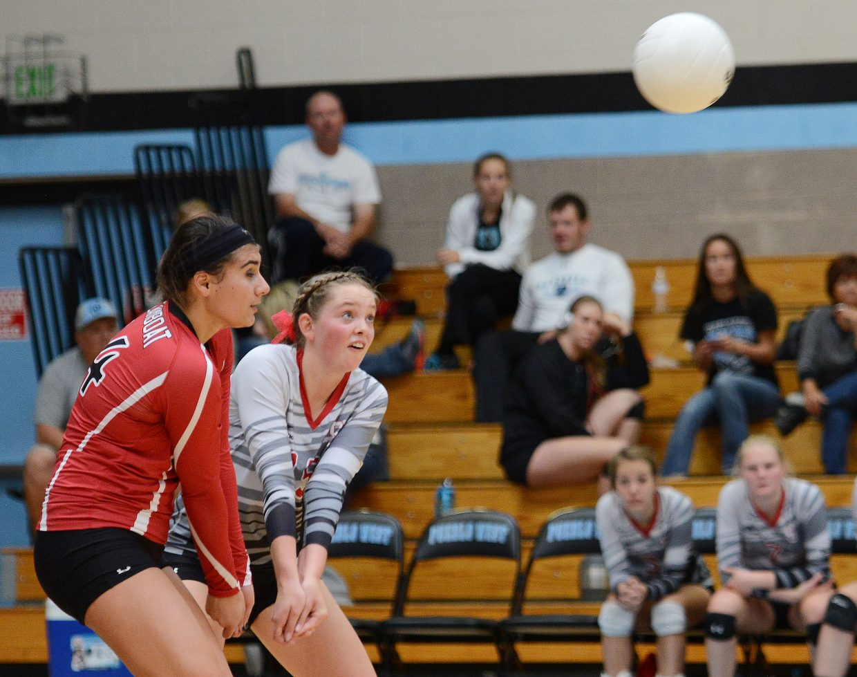Maddie Labor and Jenna Miller team up as they scramble for the ball Saturday.